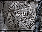 """""""The Wheel of Eternity, an Indo-Aryan symbol, curiously placed inside the Star of David: a carving on the marble tombstone of Grand Prince Hasan Jalal Vahtangian, Lord of Khachen (1431)."""" via the Armenian Apostolic Church"""