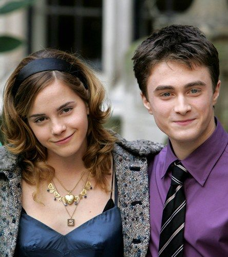 Emma Watson and Daniel Radcliffe. JUST LOOK AT THEM THEY ARE SO CUTE. I believe this was taken around the time of Prisoner of Azkaban.