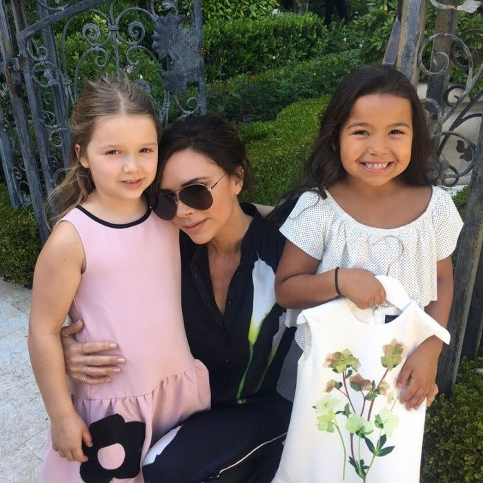 """Mini-fashionistas! Victoria Beckham snuggled up next to her daughter Harper and a friend, at the Victoria Beckham for Target Launch Event in L.A. The former Spice Girl proudly kept her daughter by her side at the star-studded bash, while she revealed her new line for the department store. Harper was happy to wear one of her mom's designs and amused by the festivities, which included live """"mermaids"""" swimming in the pool."""