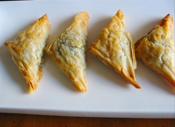Kittencal s Greek Spinach and Feta Puff Pastry Triangles from Food.com:   								I have been making these for years for my get togethers and I sometimes make these using phyllo dough but puff pastry is really just as good and more convenient --- I sometimes add in roasted garlic into the spinach mixture and also a pinch of cayenne pepper for a bit of heat --- these are so good and make wonderful appetizers!
