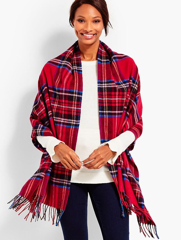 "Tartan Plaid Faux-Fur Wrap | Talbots  A statement and a staple, all at the same time. Made with super soft wool, our new, must-have wrap features plush faux-fur trim and long, hanging tassels. Tartan plaid lends holiday cheer. One size Removable Faux-fur trim Tassel hem Placed tartan plaid print throughout Length: approximately 30"" Body: 50% wool/50% acrylic (excluding decoration) Faux fur: 89% modacrylic/11% polyester Dry clean Imported"