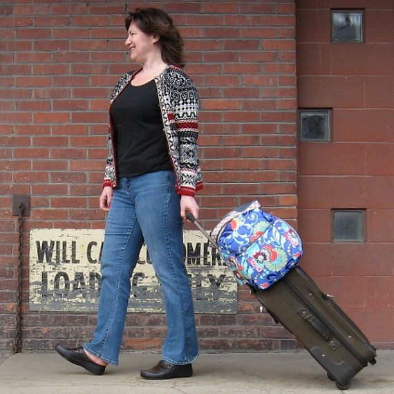 Sewing pattern for a new, slightly smaller, travel duffle. This one is perfect as a carry-on. I have included a built-in sleeve for carrying the duffle on the handle of your rolling bag. The dimensions are: 18 inches wide by 11 inches tall and 9 inches deep. For those of you who have the original pattern, I will do some comparison here: -The original duffle is 20 by 12 by 12. -This bag is washable in your washing machine. -The straps are 2 wide polypro or nylon, still lots of opportunity to…