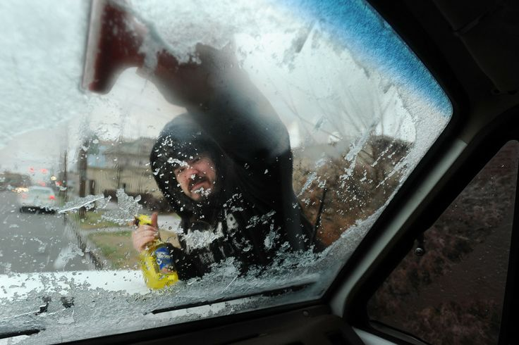 BETTER VIEW: Seth English cleared ice from his car windshield in Owensboro, Ky., Friday. The National Weather Service issued winter-storm wa...