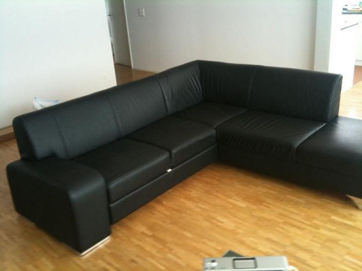 l shaped black leather sofa