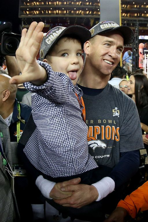. Peyton Manning #18 of the Denver Broncos holds his son Marshall after the Denver Broncos defeated the Carolina Panthers with a score of 24 to 10 to win Super Bowl 50 at Levi\'s Stadium on February 7, 2016 in Santa Clara, California.  (Photo by Streeter Lecka/Getty Images)
