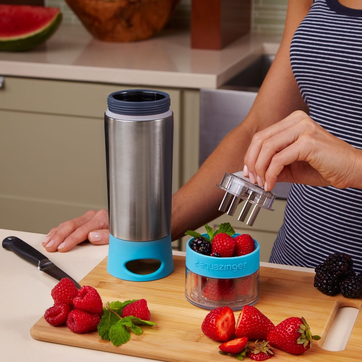 Water bottle with fruit infuser on the bottom. Pretty cool! Stainless steel screen keeps the pulp from getting through, so you just get the juice in your drink.