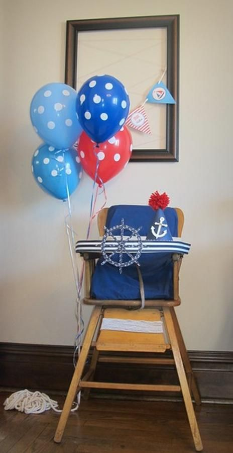 high chair with ship wheel & balloons