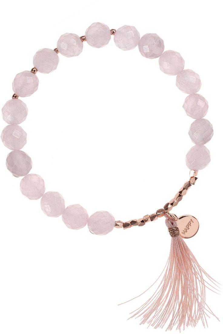 rose quartz bracelet with 'happy' tag...