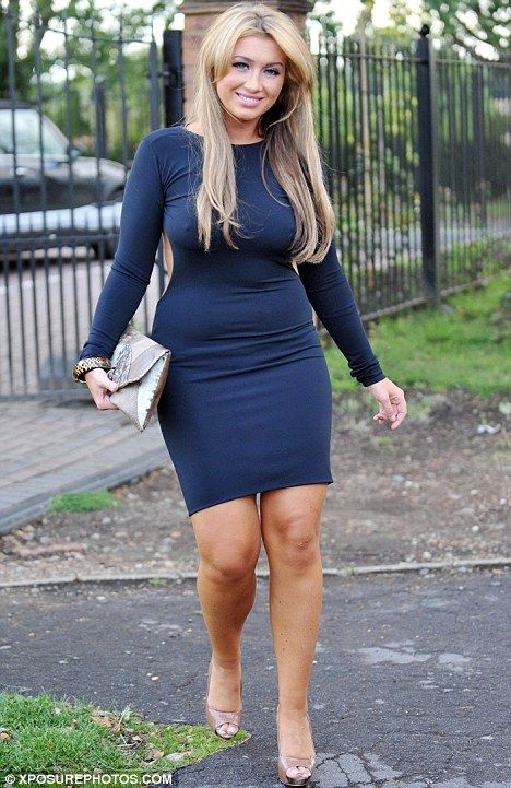 Curvy and proud: Lauren Goodger showed off her figure in a navy bodycon dress as she headed out in London