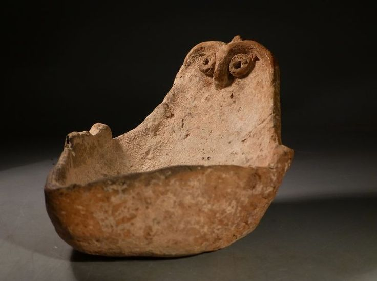 Canaanite Syro-Hittite terracotta anthropomorphic lamp, Middle Bronze Age IIa, 2000-1750 B.C.  The stylized face image can be compared with Syro-Hittite - Northern Canaanite Middle Bronze Age terracotta bird face idols. The lamp shape can be compared with the Canaanite lamps of the period, 13 cm long. Private collection