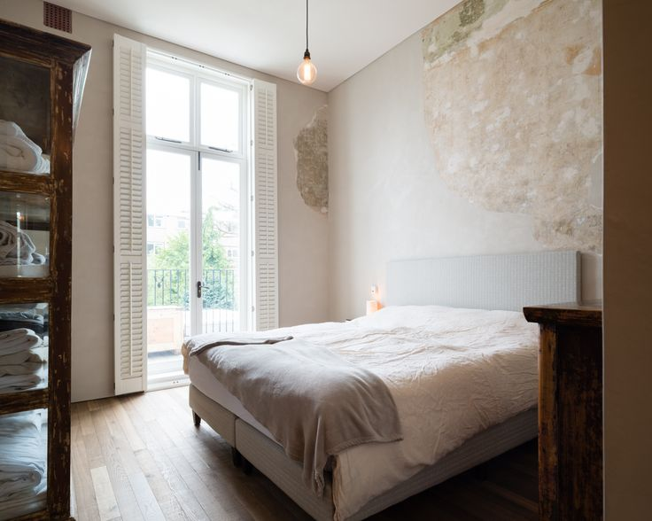 Refurbishment of terraced home in Belsize Park, London.  Bedroom. Interior Design.  Solid Timber Floor by Ted Todd. Polished Plaster by Calfe Crimmings. Joinery by Goldcrest of London. Photographer - Jim Stephenson. Contractor - Mallett Construction.
