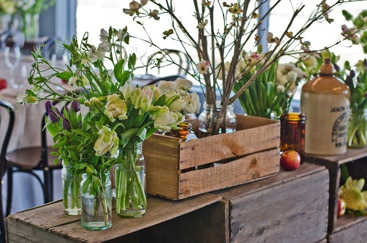 apple crates filled with beautiful spring blossoms, apples, tulips