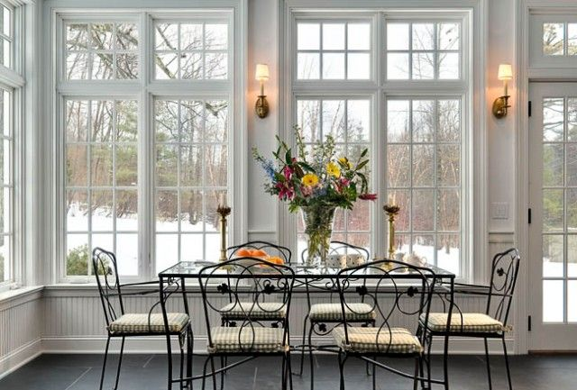 Interior design dining room with sun room additions and elegant black metal dining furniture - Sunroom dining room ...