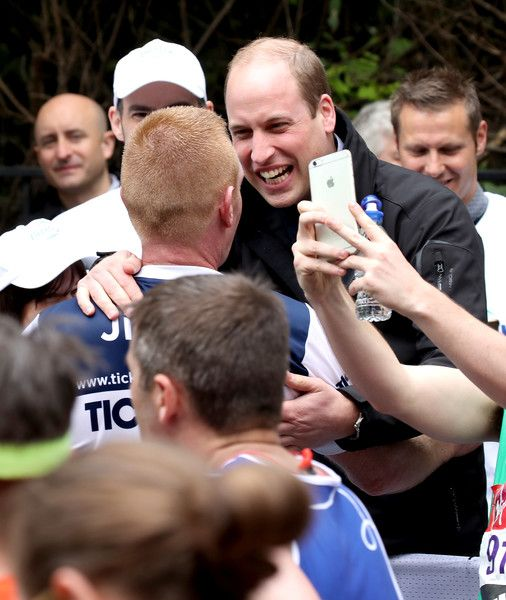 Prince William, Duke of Cambridge hugs a runner as he hands out water during the 2017 Virgin Money London Marathon on April 23, 2017 in London, England. The Duke and Duchess of Cambridge and Prince Harry, are spearheading Heads Together, in partnership with eight leading mental health charities, that are tackling stigma, raising awareness, and providing vital help for people with mental health problems.