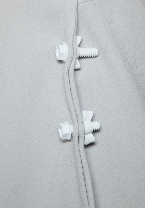 Plastic nuts & bolts as fasteners; sewing; creative fashion design detail // Christopher Kane S/S 2013