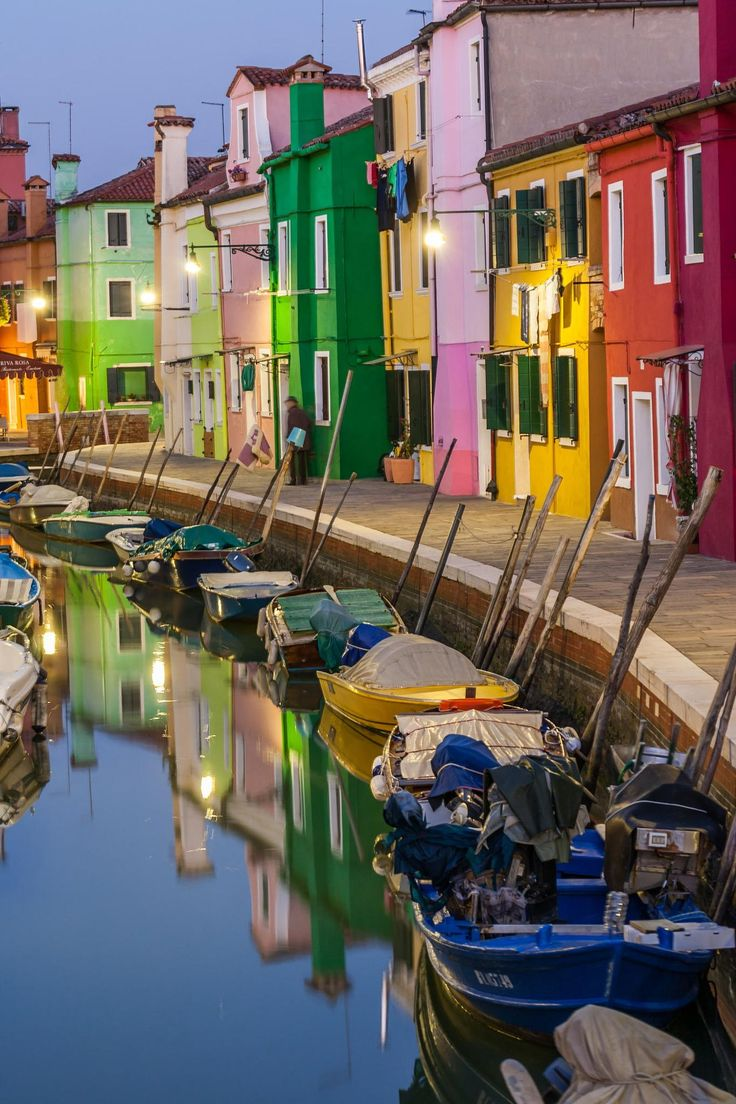The island of Burano is famous for its pastel-colored houses and lace-making. The island, about half-hour by ferry ride from Venice, is very picturesque.