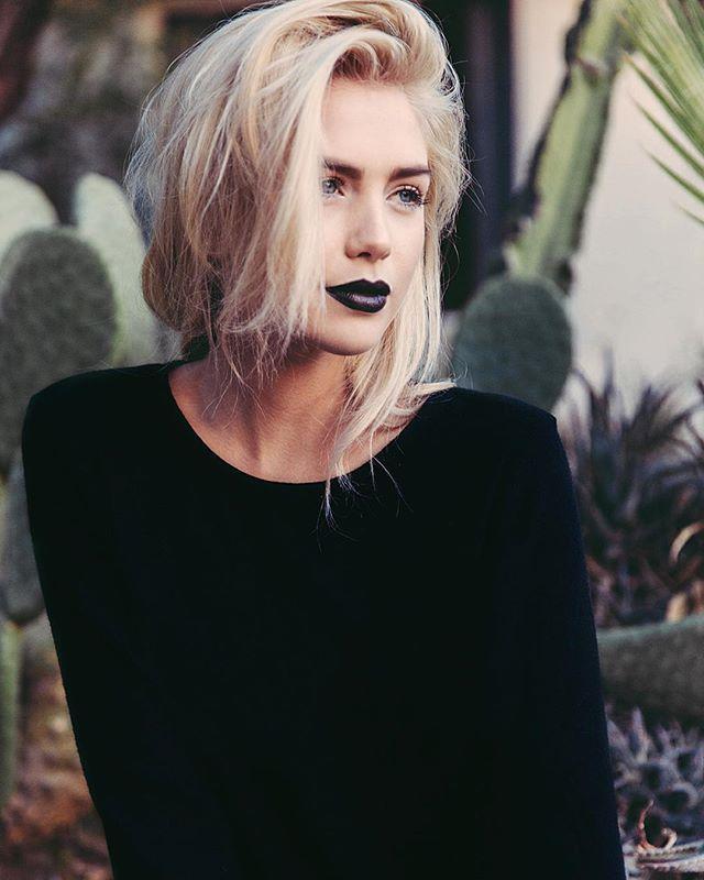 90's dark lipstick, pale skin, thin distressed sweater.