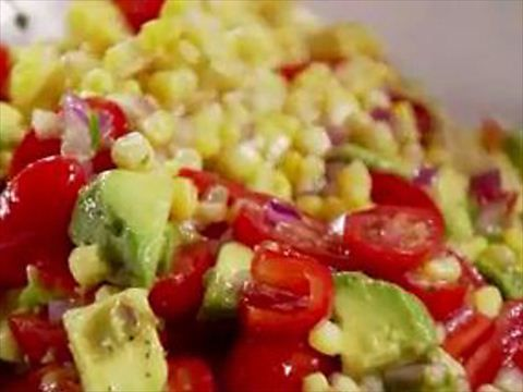 Delicious corn, avocado and tomato salad from Ina Garten. I like to add cilantro for an extra flavor. Salad tastes so fresh! Make sure to use fresh corn. Sliced hearts of palm is a great addition as well.
