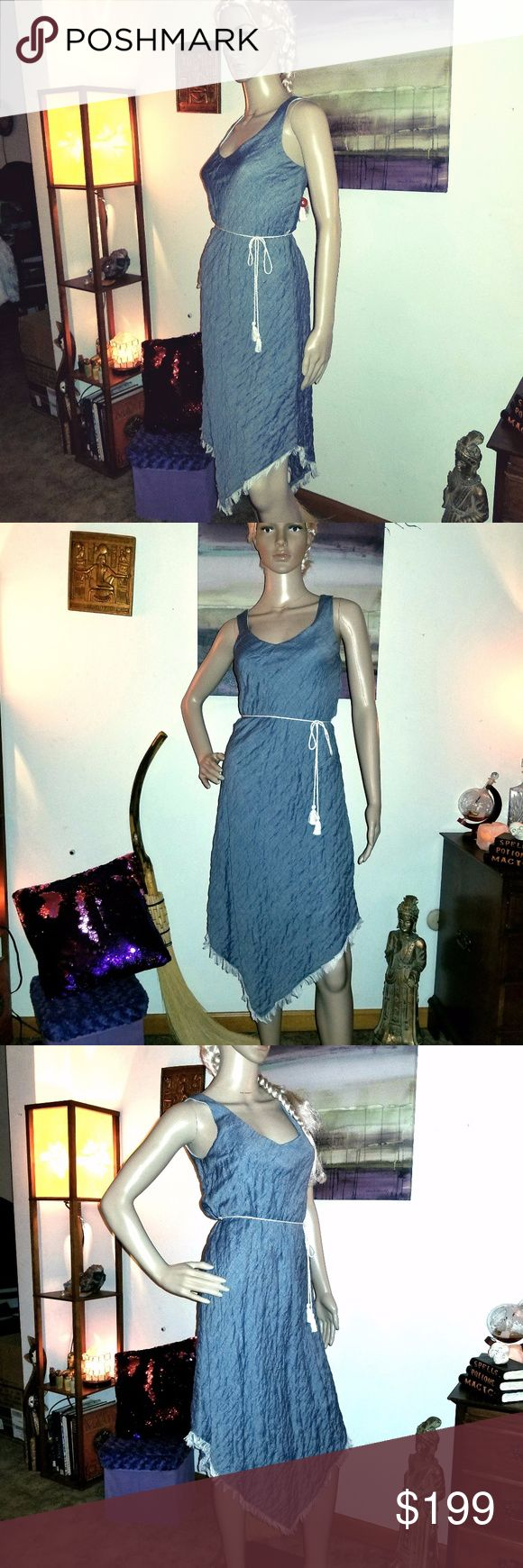 """🎉HP & NWT🎉DREW Indigo Asymmetrical Krista Dress 🎉HP - 9/25/17🎉  ☕This fantastic piece by DREW has a gorgeous, """"puckered"""" texture, white fringe along the asymmetrical hem, & features a gorgeous indigo/denim blue.  100% Cotton w/ 100% Rayon white lining, this dress has a fitted top/bodice w/ a matching white rope belt & drapes down below the knee in the front & back in a playful cut.  Pair w/ cropped jacket & booties for a stunning, high-end look.🌟NYC Designer Exclusive 2017🌟- designs…"""