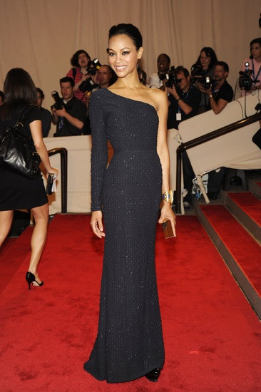Zoe Saldana: Zoe Saldana went for a minimalist-chic look for the 2010 Met Gala — she wore a one-shoulder Calvin Klein column gown with a sleek, slicked-back hairstyle.