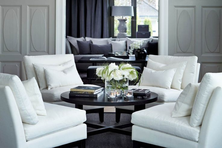 perfect coffee table styling - fresh contemporary floral arrangement candles and well chosen books Slettvoll