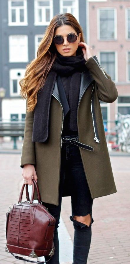 Olive green coat with an all  black outfit & bugundy handbag