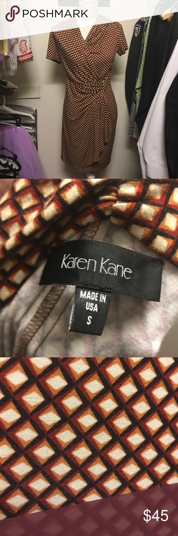 Karen Kane asymmetrical wrap dress size small Karen Kane asymmetrical wrap dress size small. Gorgeous print as shown in photos. Great Fall look. Very stretchy! I'm a size 6 and it fits me well. Karen Kane Dresses