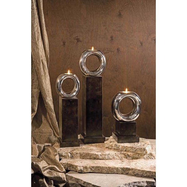 IMAX CKI Ellipse Votive Holders - Set of 3. Carolyn Kinder designed modern mahogany color based, silver oval toped votive candle sticks, set of three in graduating sizes.
