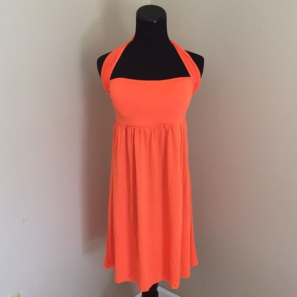 NEW Multi-Way Swimsuit Beach Cover Up in Orange Brand new. Empire waist. Wear as a halter neckline or strapless and tie around the middle. Spandex/polyester blend. Soft, lightweight, stretchy material. Lightly padded top, removable. Size fits S-L. NO TRADES Swim Coverups
