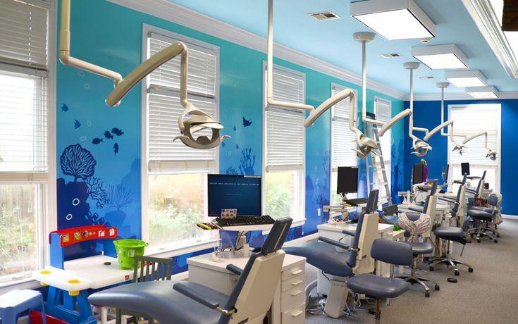 Ocean silhouette murals in a pediatric dental treatment room by Imagination Dental Solutions