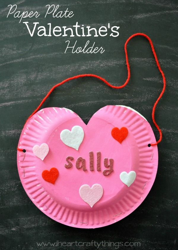 Make a simple and cute Heart Valentine's Holder out of paper plates. Great preschool and kids craft for them to exchange Valentine's on Valentine's Day or at home for parents and siblings to pass love notes. | From iheartcraftythings.com