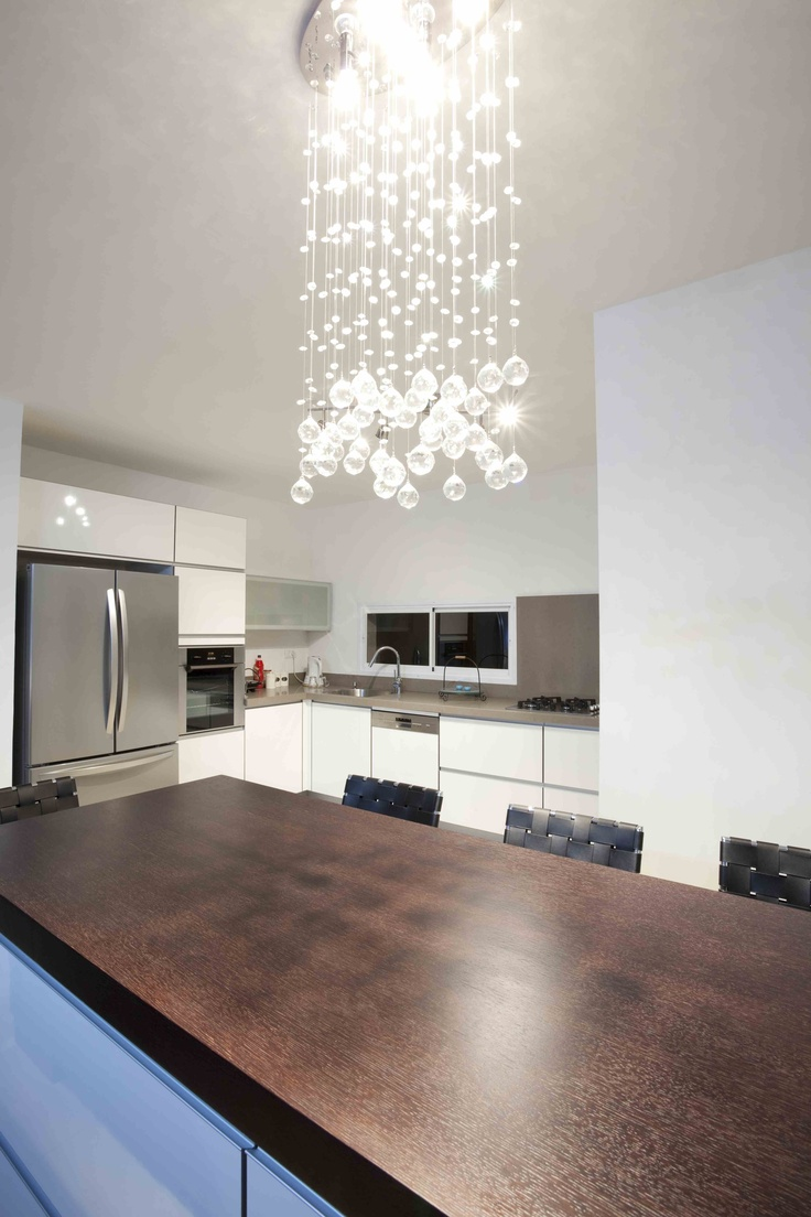 Al al alno kitchen cabinets chicago - Bubble Chandelier And Wood Island Top With Quartz Countertop Perimeter Species Wenge