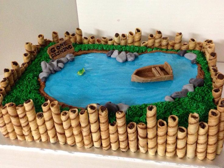Fishing pond cake with pretty blue water. Going to add beavers to this and take away the boat per son's request.  Think I'll nail it?  LOL