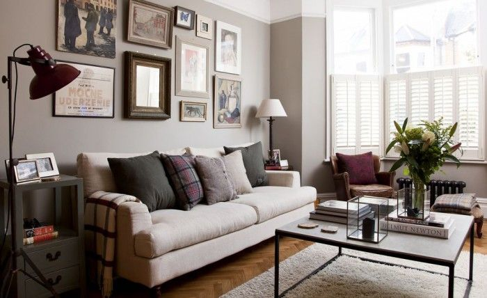 A gallery of prints and posters in the living room of this extended Victorian flat turns a blank space into an eyecatching feature wall. Plan your arrangement with pieces of paper laid out on the floor before fixing the frames in place.