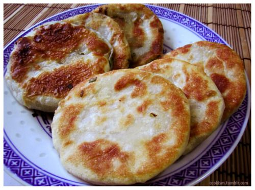 The Chinese green onion pancake, or cong you bing in Mandarin, is an ethnic savoury flatbread that originated from parts of China and Taiwan. Contrary to its name, green onion pancakes differ from true pancakes as they are made of dough instead of batter, giving them a slight crispiness. Legend has it that Marco Polo loved cong you bing so much that when he returned to Italy, he sought out chefs who were willing to recreate the dish. After a series of failures, he decided to put the fillings…