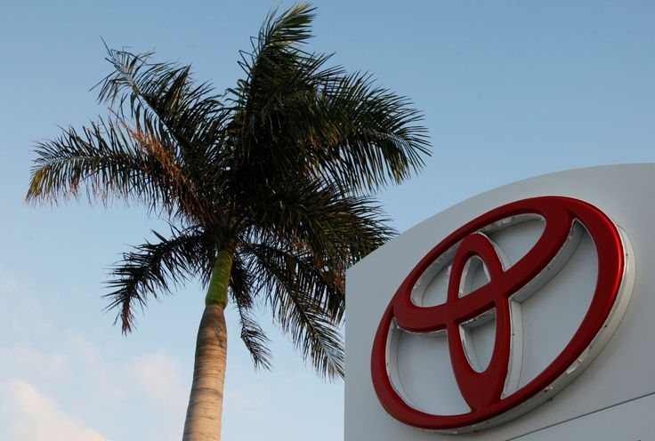 FILE - This Feb. 3, 2010 file photo shows a palm tree behind a Toyota sign at Earl Stewart Toyota in... - AP Photo/Wilfredo Lee, File