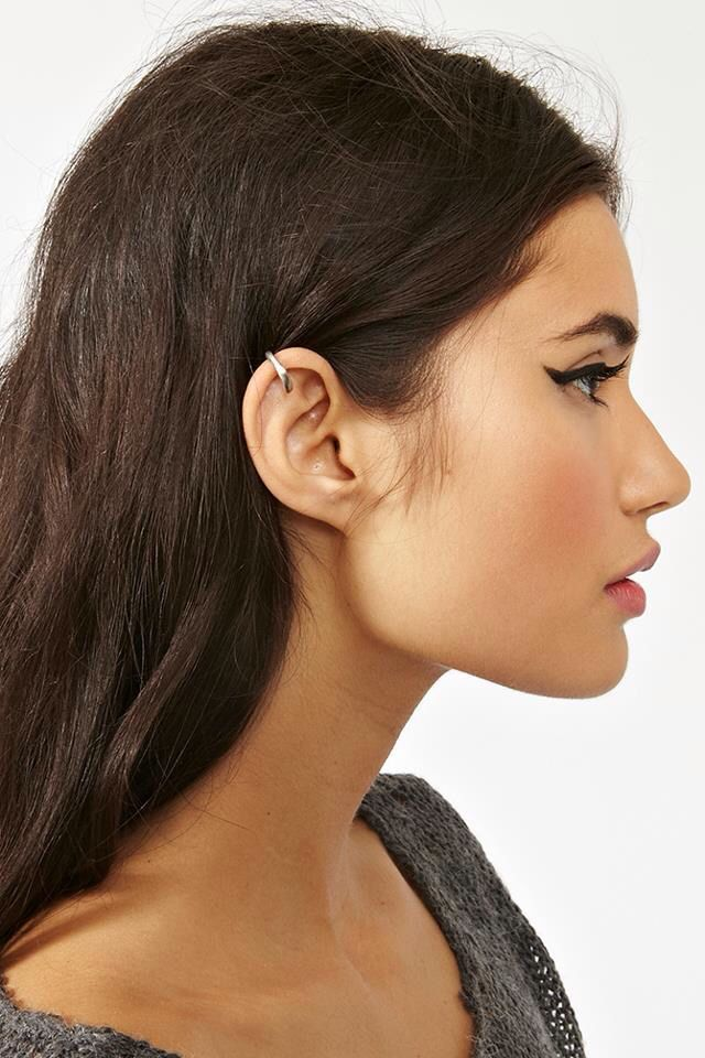 a wing and a statement earring