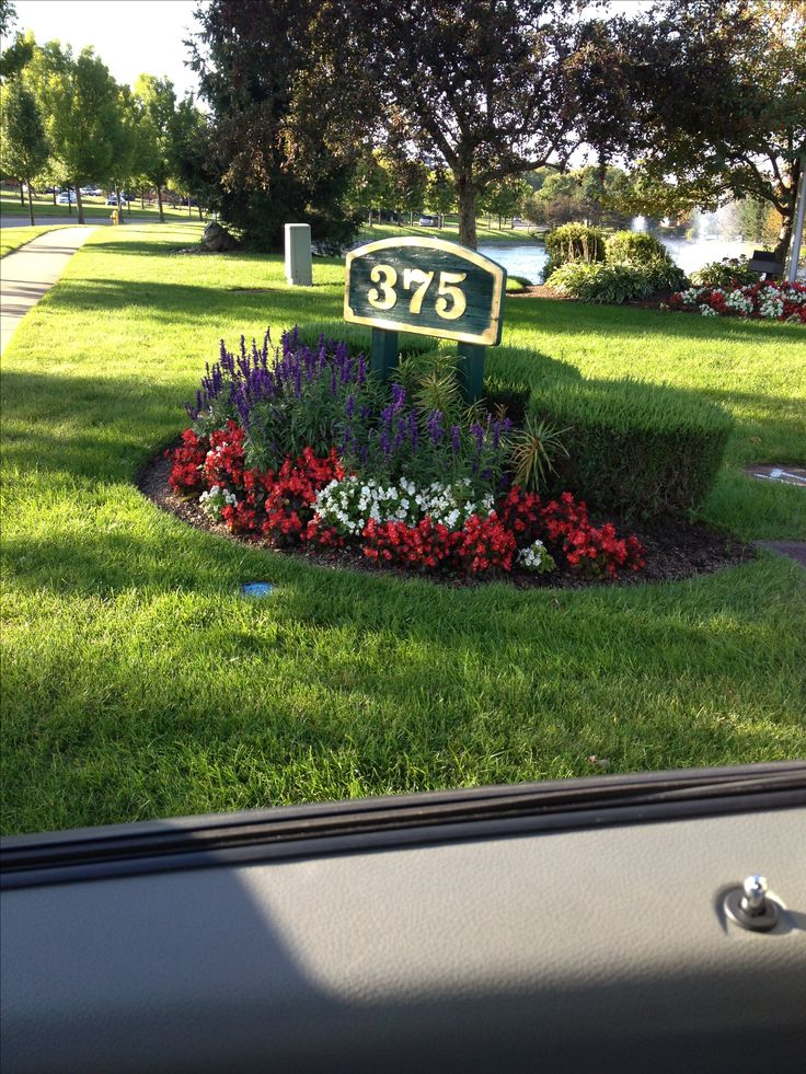 Landscaping and House number  @Sharon Rote-Patton  - what if you put a circle garden at the top of your front yard, .... hard to explain where I'm thinking.... So it can be seen by the road, the flat area/corner of your front yard that if you walked you'd go over your front back or down the driveway bank.