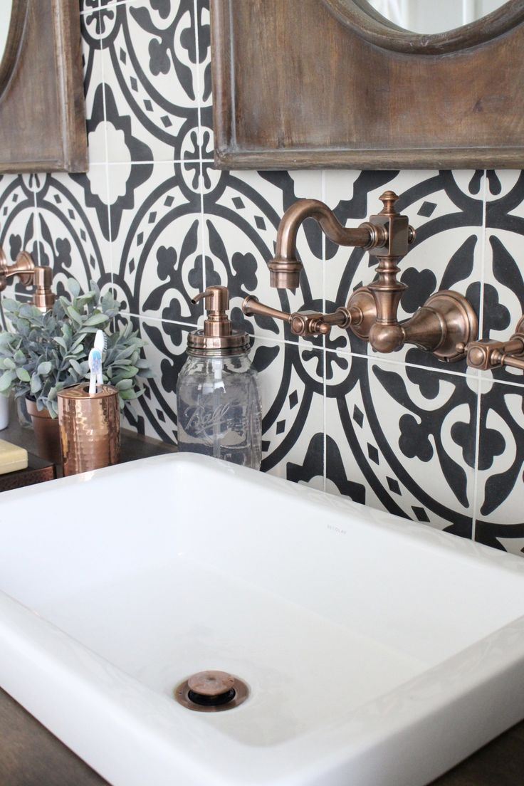 Master Bathroom Renovation- bathroom- remodeled bathroom-  bathroom- cement tile- copper accents- bathroom update- bathroom reveal- black and white patterned tiles