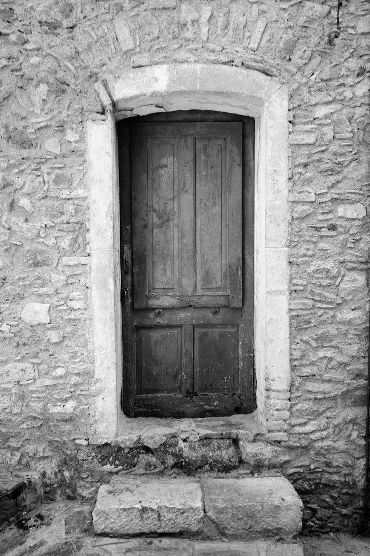 Stone wall old door cool black white websites pinterest for Door of stone