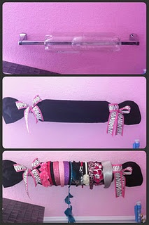 Headband holder using 2 liter bottles covered in material then hung on a towel rack.