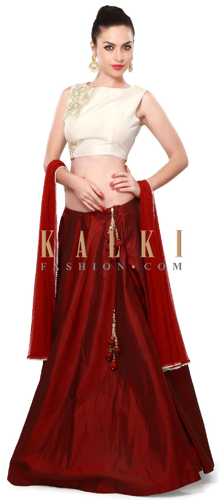 Buy Online from the link below. We ship worldwide (Free Shipping over US$100). Product SKU - 276601. Product Price - $489.00. Product link - http://www.kalkifashion.com/maroon-lehenga-adorn-in-zari-and-pearl-embroidery-only-on-kalki.html