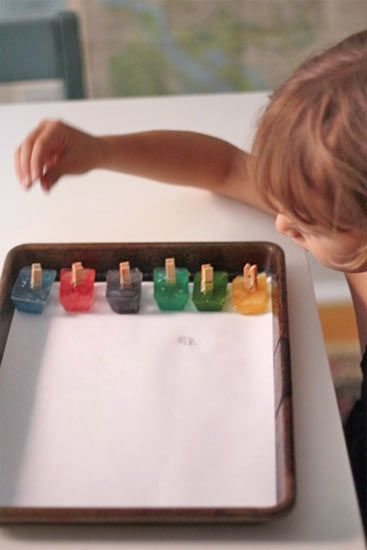 Painting with ice: This is so easy to do. And clean up is easy too if you put it in a pan. -