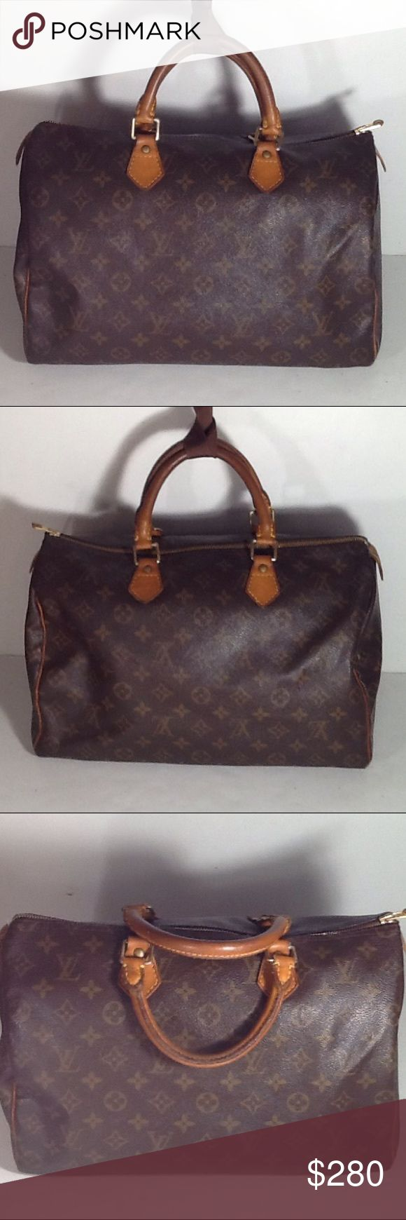 Authentic Louis Vuitton Speedy 35 Monogram Satchel Handles and leather showed wearing. Handle had sone light scratches. Canvas showed wearing on the  bottom corners. The inside linen are good. The bag was made in France with a date code MB 0012. The one leather piece to hold lock and key was replaced. Louis Vuitton Bags Satchels