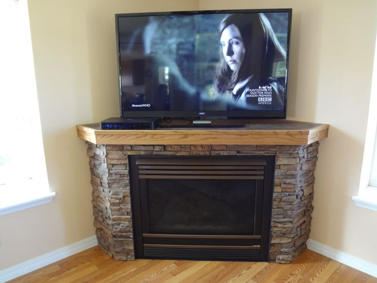 marvelous stacked stones corner fireplace with tv stands