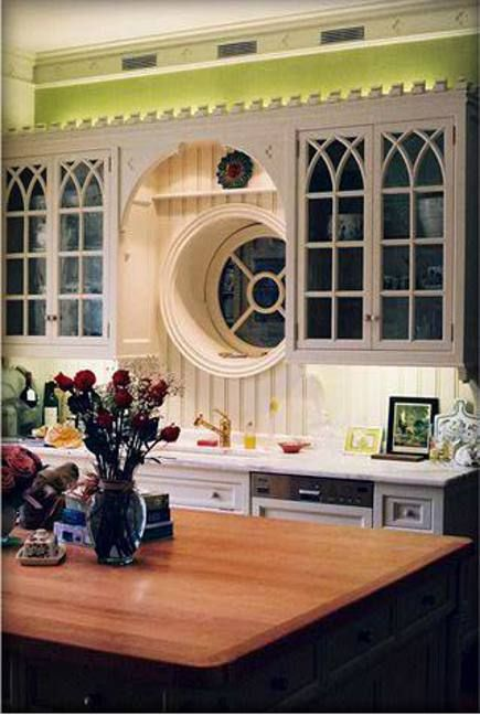 Gothic details on upper cabinets of white Gothic revival kitchen