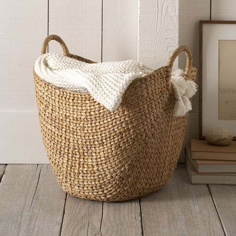 "Large Curved Basket A grand-scale carryall made from rapidly renewable water hyacinth provides stylish, shapely storage for newspapers, magazines, blankets, and more.          • Water hyacinth.    • Handles for easy portability.    • 20""l x 15""w x 20""h.     • Wipe clean.     • Imported.  $54.00 so many uses - have to have ...."
