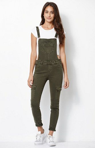 Versatile and fashionable, the Utility Overalls offer an ankle length and skinny fit. Buckled suspenders and a warm olive tone make them truly must-have.    FIT + SIZING    Skinny fit Slim from hip to hem Hits at ankle Narrow 10.25'' leg opening 27.5'' inseam   FABRICATION + CARE    Olive green wash Stretch fabric Utility pockets 77% cotton, 13% rayon, 9% polyester, 1% spandex Machine washable   MEASUREMENTS    Model is wearing a size 25 Model's measurements: Height: 5'9'' ...