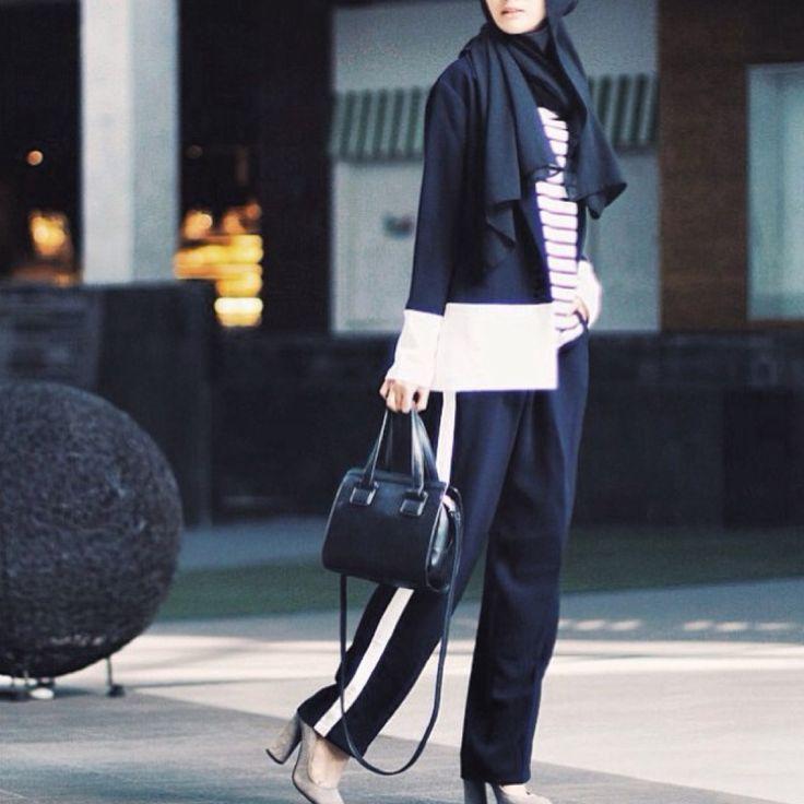 Fashion blogger Puteri Hasanah karunia is wearing our Padma stripe pants and Taraka two tone blazer. Now available at shopnefertiti.com.