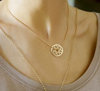 The openwork target with cloverleaves, a bestseller among Lilou's clients! Ornament your neck with this subtle and lucky jewel, in silver or gold-plated #lilou #necklace #cloverleaves #target #lucky #jewel #silver #gold-plated